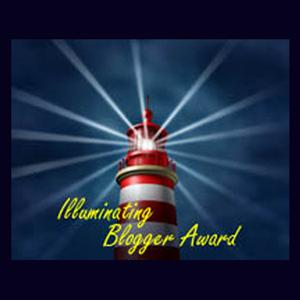 "Drawing of lighthouse against a dark background with rays of light spreading out from it. Caption reads ""Illuminating Blogger Award."""